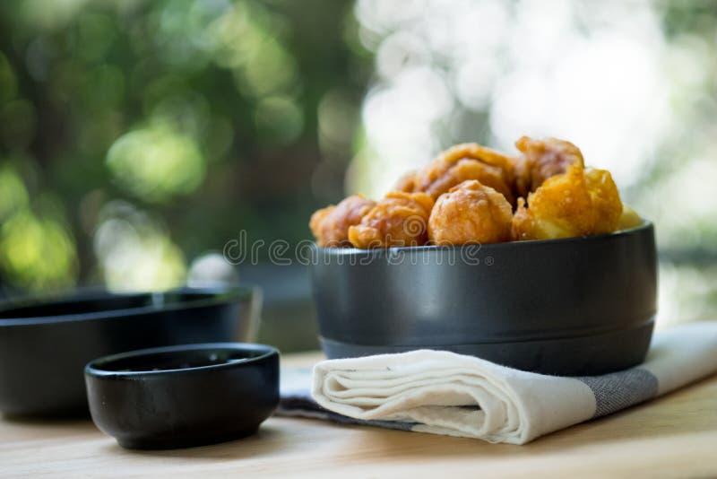 Crispy fried balls in black bowl royalty free stock photos