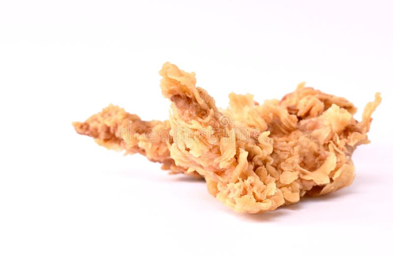 Crispy fried chicken fillet with bread crumb and egg yolk on white background royalty free stock images