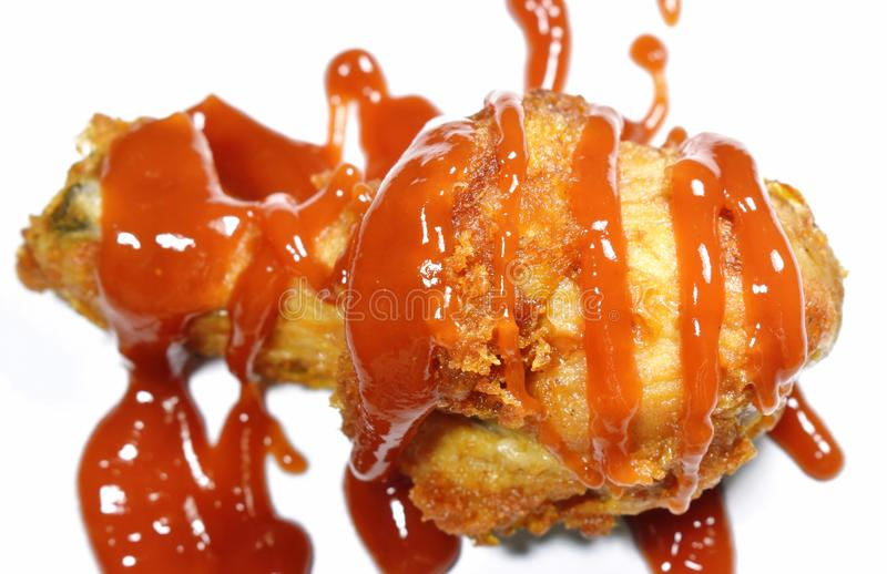 Crispy fried chicken leg dressing ketchup sauce on white background stock photography