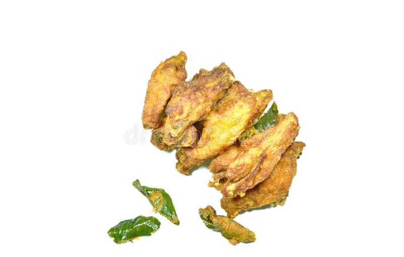 Crispy fried chicken wing with lemon grass on white background royalty free stock photo
