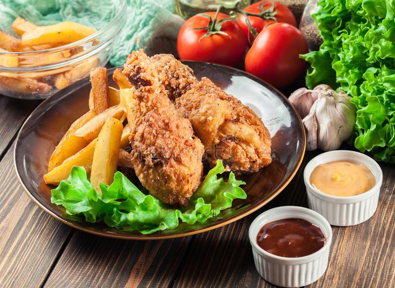 Chicken legs and french fries with barbecue sauce stock - Kentucky french chicken ...