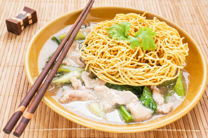 Crispy fried noodle with pork soaked in gravy royalty free stock photo