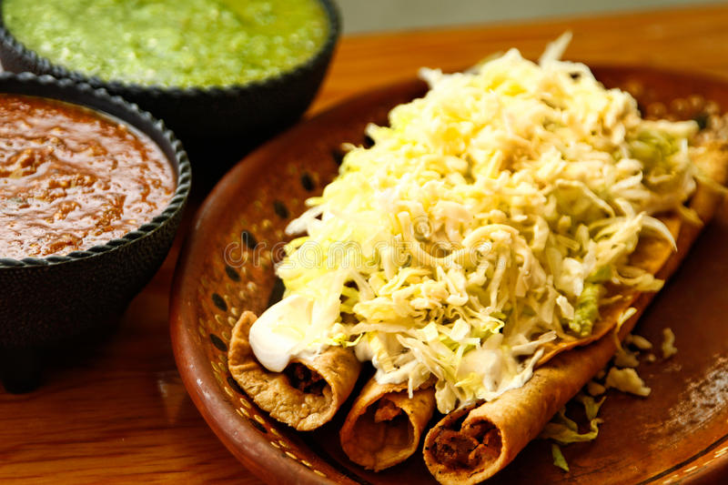 Crispy Fried Tacos with sauces royalty free stock photography