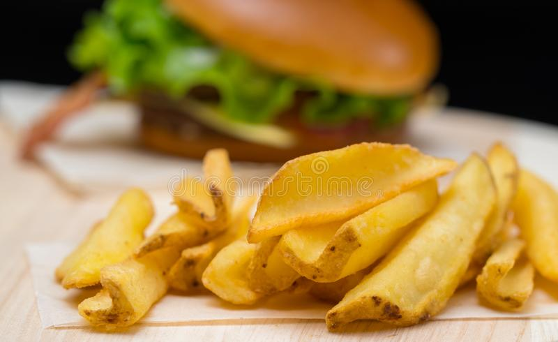 Crispy golden deep fried potato chips royalty free stock photo