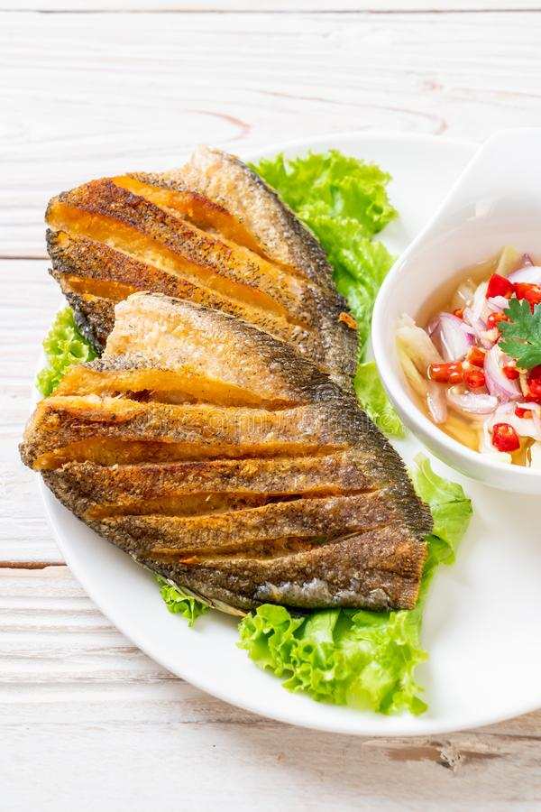 Crispy gourami fish with spicy salad. Asian food style royalty free stock photos