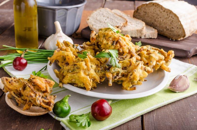 Crispy onion bhajis. Delicious street food, with herbs and garlic stock photo