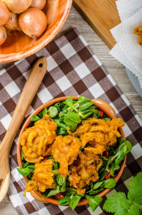 Crispy onion bhajis. Delicisous brazilian street food on salad stock photos