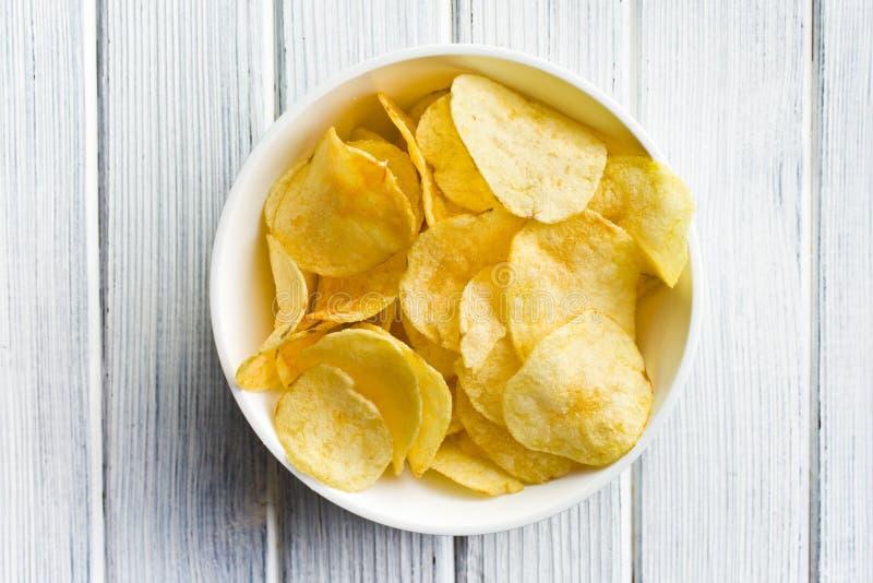 Crispy potato chips in bolw royalty free stock photos