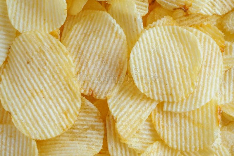 Crispy potato chips snack texture background stock photo