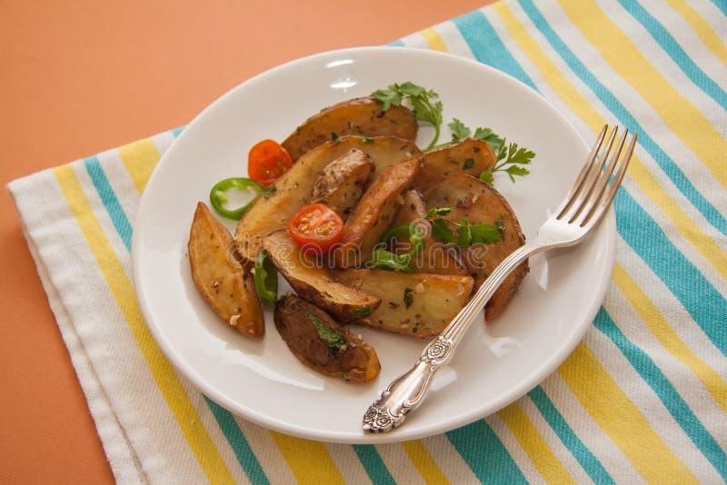 Crispy potato. Roasted potato with fresh vegetables stock images