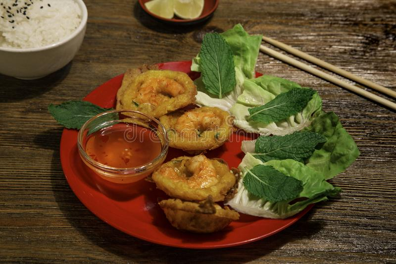 Crispy rice pancakes with prawns, Vietnamese mint leaves or banh khot, khot cake stock image