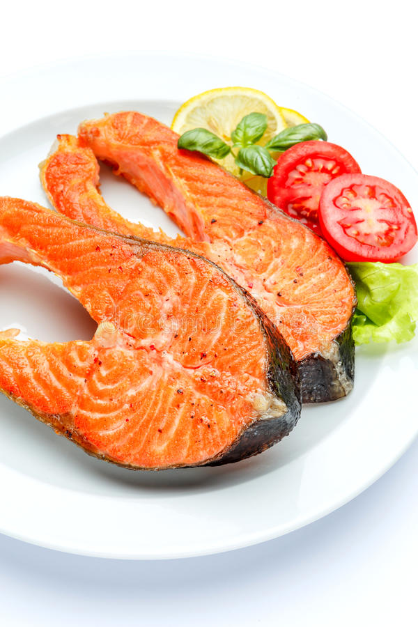 Crispy roasted salmon steak. On white background stock photo