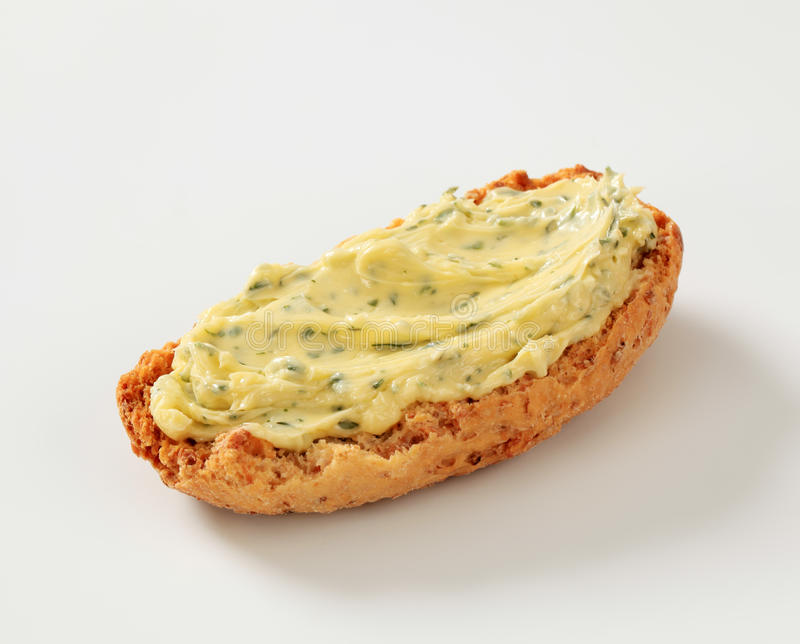 Crispy roll and herb butter royalty free stock images