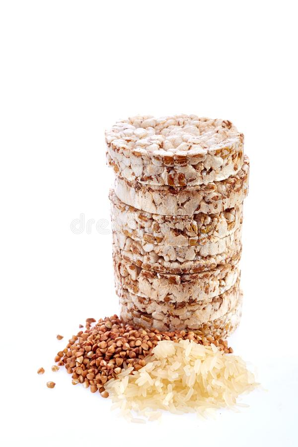 Crispy round dietary buckwheat rice fitness bread isolated on white background. royalty free stock image
