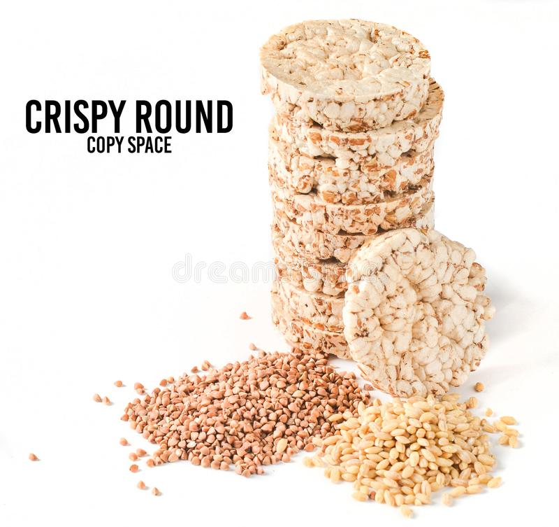 Crispy round dietary buckwheat rice fitness bread isolated on white background. Food for weight loss. Crispy round dietary buckwheat rice fitness bread isolated stock photos