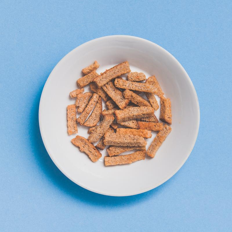 Crispy rusk on white plate, beer snack royalty free stock photos