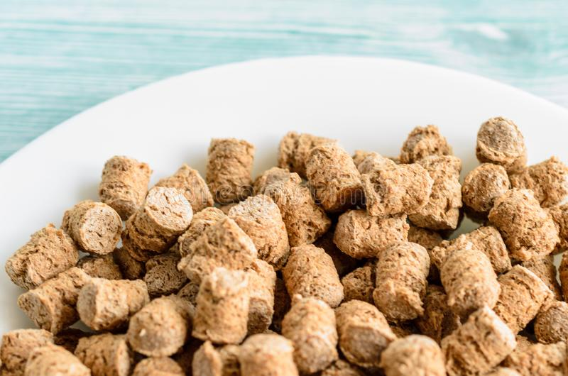 Crispy bran in the white plate, healthy dieting snack royalty free stock image