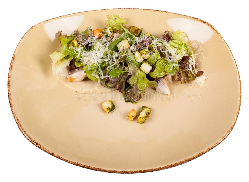 Crispy salad mix with tender chicken, fragrant brisket and basil crackers with Caesar dressing royalty free stock photo