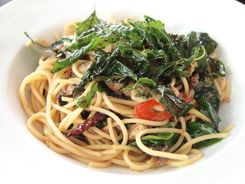 Crispy Salted Fish Spaghetti stock photos