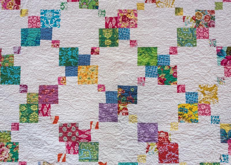Criss Cross of Color on White Background. On Homemade Quilt stock photos
