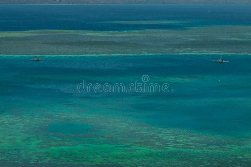 Cristal Clear blue Water lagoone with boats, Riung Flores Indonesia royalty free stock photo