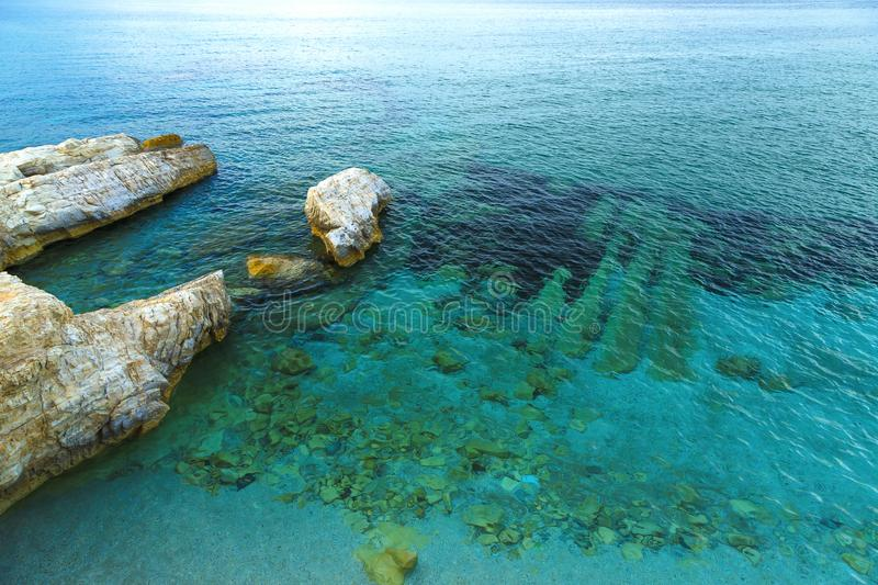 Cristal clear turquoise water and the sea urchins on bottom, coast of Crete, Greece. wave pattern, wind ripples the sea stock photo
