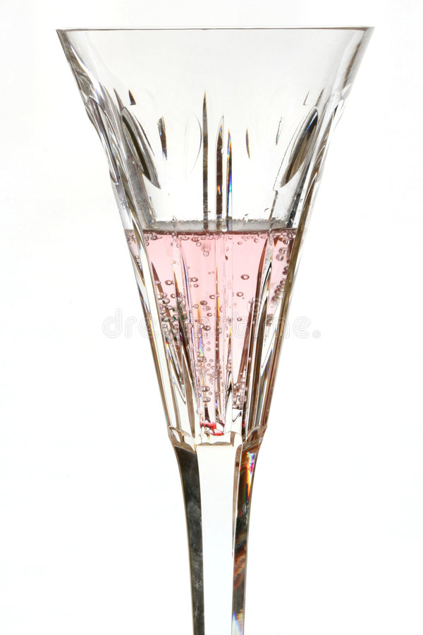 Cristal com líquido cor-de-rosa imagem de stock royalty free