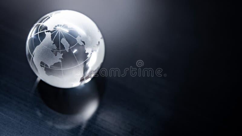 Cristal do globo do mundo Negócio global foto de stock