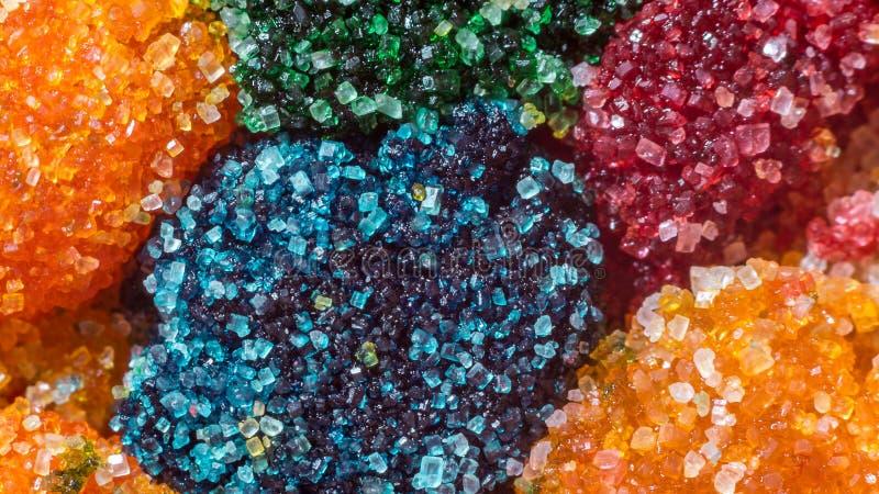 Cristales coloreados macro del azúcar fotos de archivo