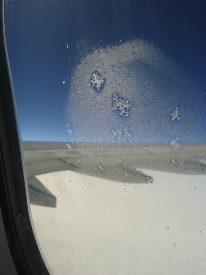 Cristaux de neige de fenêtre d'avion image libre de droits