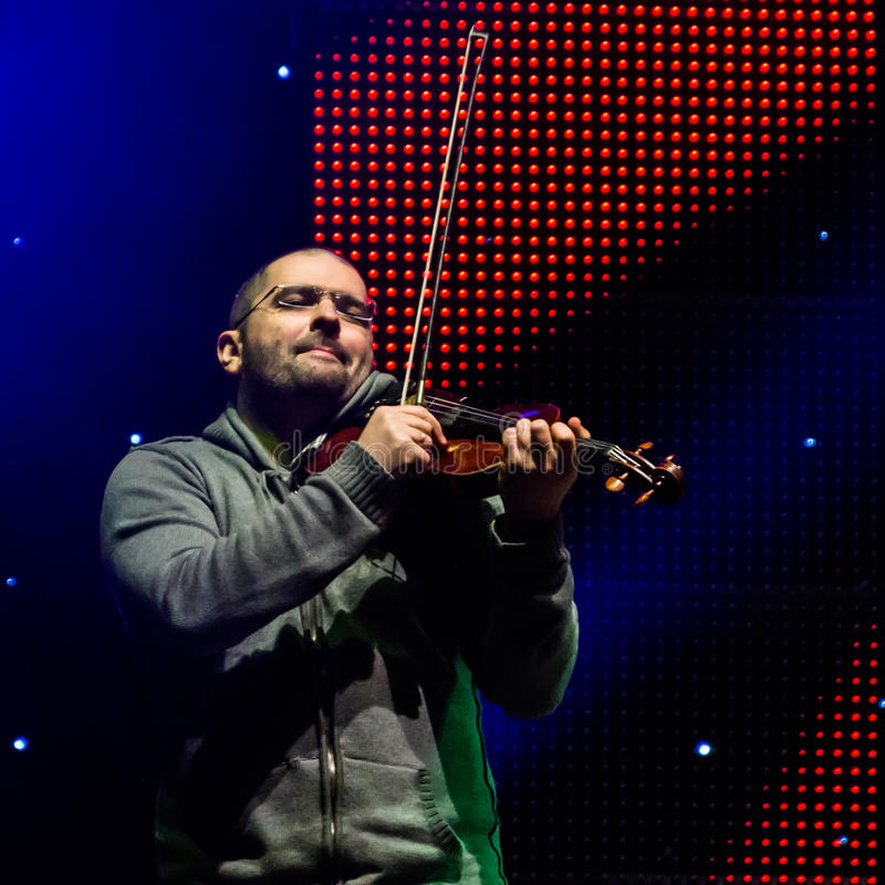 Cristi Horia. (violin) alias Kiba from Mihai Mărgineanu (singer) Band at New Years Eve 2014 concert organized by District 3, Bucharest royalty free stock images