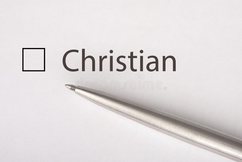 Cristiano - checkbox con una señal en el Libro Blanco con la pluma del metal Concepto de la lista de control fotos de archivo