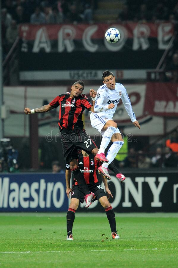 Cristiano Ronaldo and Kevin Prince Boateng in action during the match. Milan, Italy , 03 NOVEMBER 2010, `San Siro` Stadium,  UEFA Champions League 2010/2011, AC royalty free stock photo