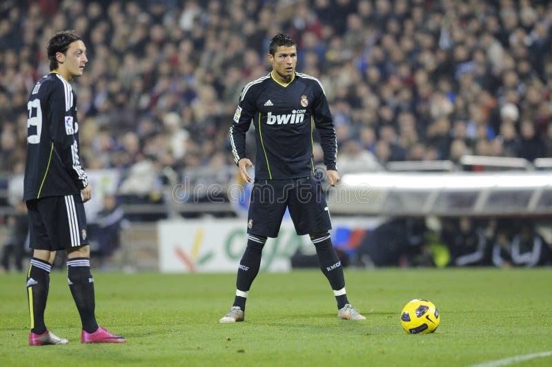 Cristiano Ronaldo and Mesut Ozil. Ronaldo and mesut ozil preparation before taking a free kick royalty free stock image