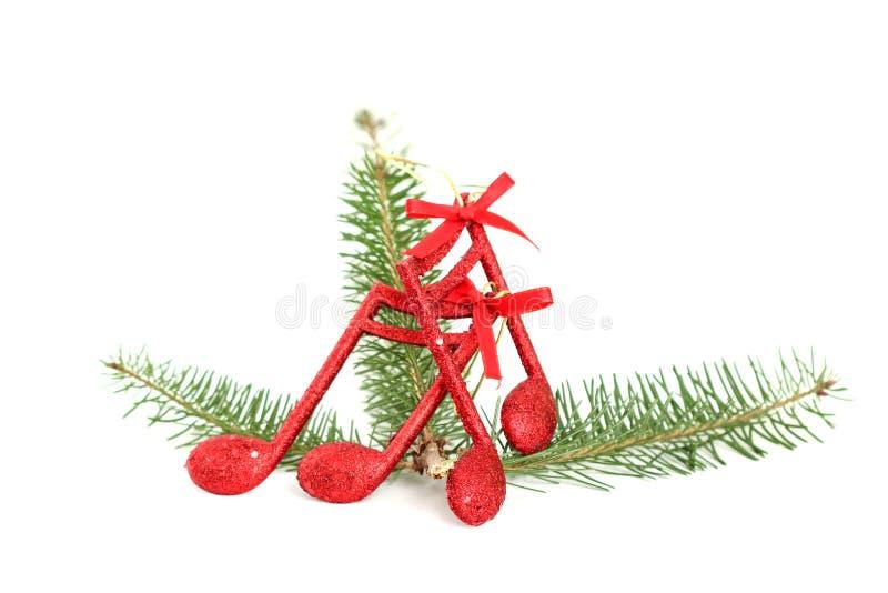 Cristmas音乐注意在树枝的装饰 免版税库存照片