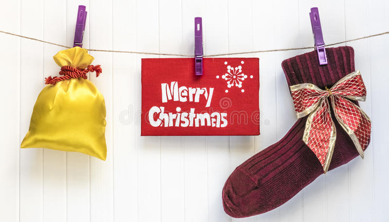 Cristmas background. Red decoration. Merry Cristmas greeting card. Merry Cristmas sock. Merry Cristmas and happy new year card with present royalty free stock image