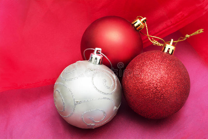 Cristmas balls decoration ornament on red cloth background royalty free stock photo
