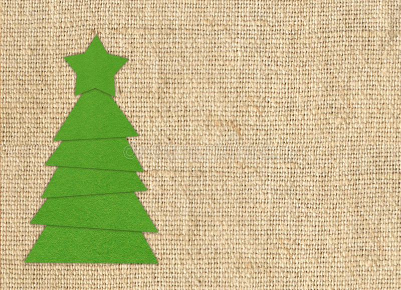 Cristmas tree cloth cutting design card over burlap stock image