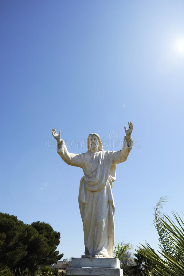 Cristo Redentor statue Christ the Redeemer Statue. Similar to the statue in Rio de janeiro. Concept of forgiveness. Father who. Forgives his son. Apulia royalty free stock photos