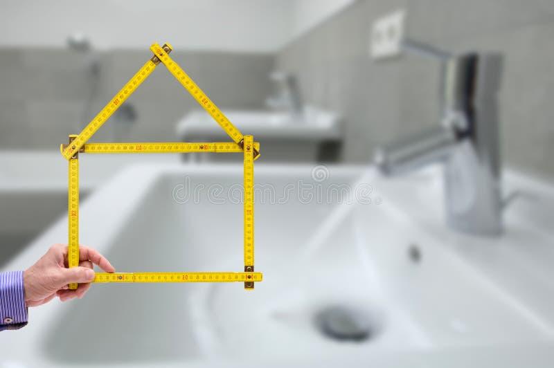 Critério dobrado no formulário de uma casa imagem de stock