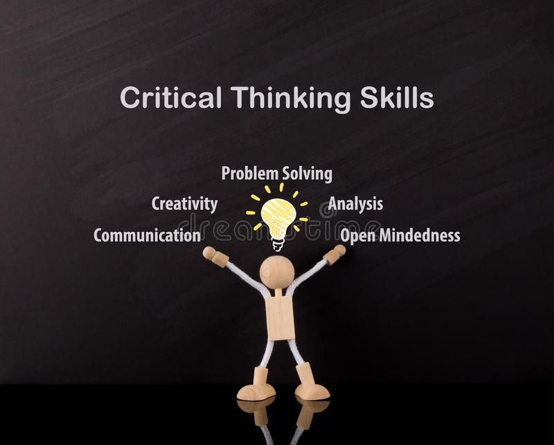 Critical Thinking Skills Concept, Wooden Stick Figure arms up, Big Yellow light bulb sketch stock images