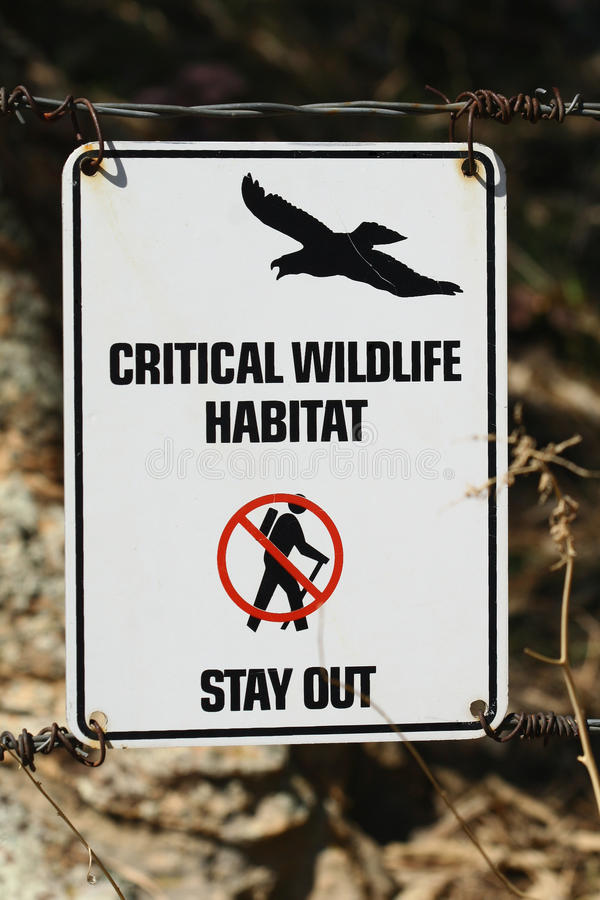 Critical Wildlife Habitat - Stay Out. A sign marks a critical wildlife habitat and urges hikers to stay on the trail and out of the area where raptors breed stock image