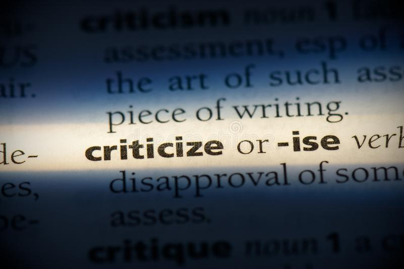 Criticize. Word in a dictionary.  concept, definition stock image