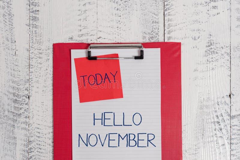 ?criture conceptuelle de main montrant le bonjour novembre Accueil des textes de photo d'affaires l'onzième mois du mois d'année  images stock