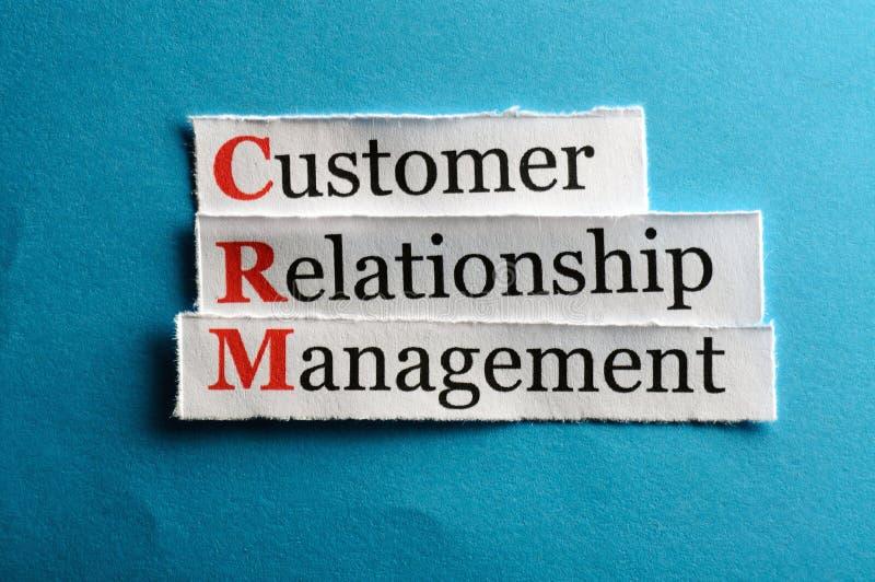 Crm abbreviation. CRM customer relation management abbreviation on blue paper