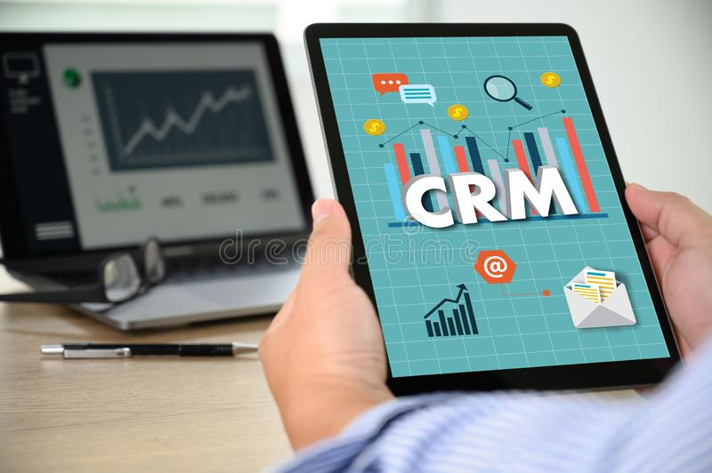 CRM Business Customer CRM Management Analysis Service Concept Business team hands at work with financial reports and a laptop royalty free stock photo