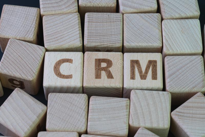 CRM, Customer Relationship Management, loyalty program, repeat purchase frequency concept, cube wooden block with alphabet combine royalty free stock image