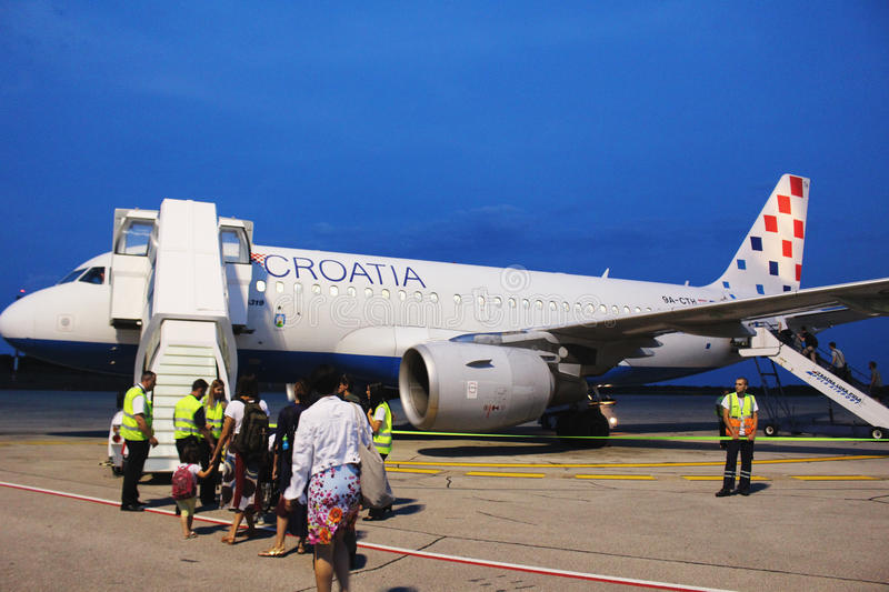 Croatia Airlines Airbus at Pula airport. PULA/CROATIA - 27 JUNE 2017: Tourists boarding a Croatia Airlines Airbus A319 at Pula airport royalty free stock photo