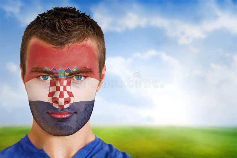 Croatia football fan in face paint stock image