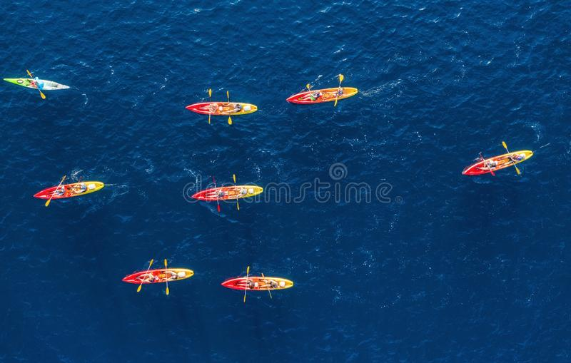 Croatia. Kayks at the sea surface. Aerial view of kyaks on blue Adriatic sea at sunny day. Adventure and travel. royalty free stock image